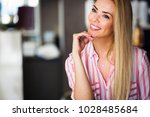 beautiful woman with long blond ... | Shutterstock . vector #1028485684