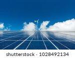solar panel and wind turbine... | Shutterstock . vector #1028492134
