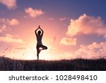 woman silhouette meditating in... | Shutterstock . vector #1028498410