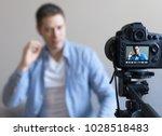 handsome man making video blog. ...   Shutterstock . vector #1028518483