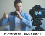 man making video blog about...   Shutterstock . vector #1028518546