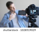 man making video blog about...   Shutterstock . vector #1028519029