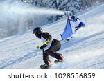 athletes on a snowboarding... | Shutterstock . vector #1028556859