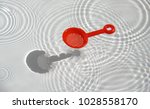 kids toy dropping in water with ... | Shutterstock . vector #1028558170