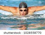 swimmer. man swimming butterfly ... | Shutterstock . vector #1028558770