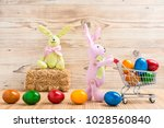 two easter bunnies with a... | Shutterstock . vector #1028560840