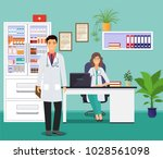 woman and man doctors in... | Shutterstock .eps vector #1028561098