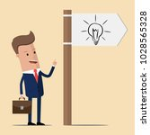 businessman with directional... | Shutterstock .eps vector #1028565328