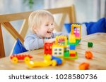 little boy playing with... | Shutterstock . vector #1028580736