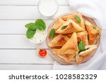puff pastry triangles filled... | Shutterstock . vector #1028582329