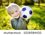little boy having fun playing a ... | Shutterstock . vector #1028584420