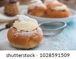 semla swedish cream bun on... | Shutterstock . vector #1028591509