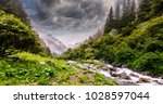 Small photo of Wonderful landscape with mountain river and overcast sky. waterfall in the mountains.Balea waterfall in Fagaras mountains, Sibiu,Transylvania, Romania. near Transfagarasan road. Hiking, travel Concept