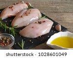 raw chicken breasts witn...   Shutterstock . vector #1028601049