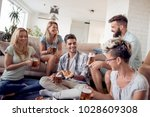 pizza lovers.group of playful... | Shutterstock . vector #1028609308