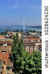 Small photo of GENEVA, SWITZERLAND - CIRCA JULY 2010: Overhead view of the Old Town, ith the Jet d'Eau in the distance