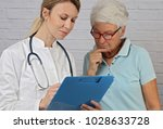 female doctor showing medical... | Shutterstock . vector #1028633728