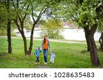 a mother plays the nature with... | Shutterstock . vector #1028635483