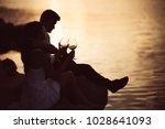 romantic couple drinking wine... | Shutterstock . vector #1028641093