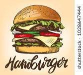 big burger  hamburger hand... | Shutterstock .eps vector #1028647444