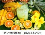 fresh sliced fruits with mug of ... | Shutterstock . vector #1028651404