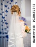wedding hairstyle  rear view   Shutterstock . vector #1028651848