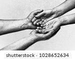 man's hands holding female... | Shutterstock . vector #1028652634