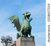 Small photo of Green dragon standing on the bridge in old Ljubljana, Slovenia