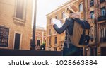 sunny day. back view. a young... | Shutterstock . vector #1028663884