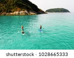 strong men floating on a sup... | Shutterstock . vector #1028665333