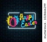 glowing neon happy easter... | Shutterstock .eps vector #1028666299
