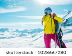 photo of sporty woman with skis ... | Shutterstock . vector #1028667280