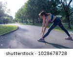 young woman doing fitness... | Shutterstock . vector #1028678728