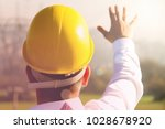 male engineer standing at...   Shutterstock . vector #1028678920