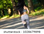 young fitness woman running... | Shutterstock . vector #1028679898