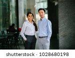 portrait of two coworkers  team ... | Shutterstock . vector #1028680198