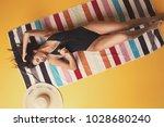 attractive model girl wearing a ... | Shutterstock . vector #1028680240