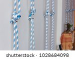 ropes attached to hook on wall... | Shutterstock . vector #1028684098