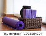 purple yoga mat rolled by... | Shutterstock . vector #1028684104