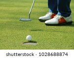 golfer putting golf ball on the ... | Shutterstock . vector #1028688874