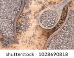 organic chia seeds on the... | Shutterstock . vector #1028690818