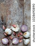 garlic and red onions on boards ... | Shutterstock . vector #1028690890