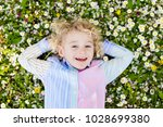 child on green grass lawn with... | Shutterstock . vector #1028699380