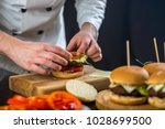 cooking burger in the kitchen | Shutterstock . vector #1028699500