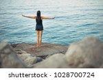 carefree calm woman meditating... | Shutterstock . vector #1028700724