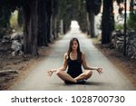 carefree calm woman meditating... | Shutterstock . vector #1028700730