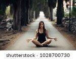 carefree calm woman meditating... | Shutterstock . vector #1028700730