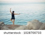 carefree woman meditating in... | Shutterstock . vector #1028700733