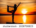 carefree woman meditating in... | Shutterstock . vector #1028700823