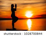 carefree woman meditating in... | Shutterstock . vector #1028700844